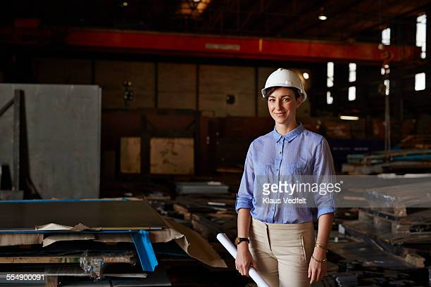 Portrait of female architect wering hard hat