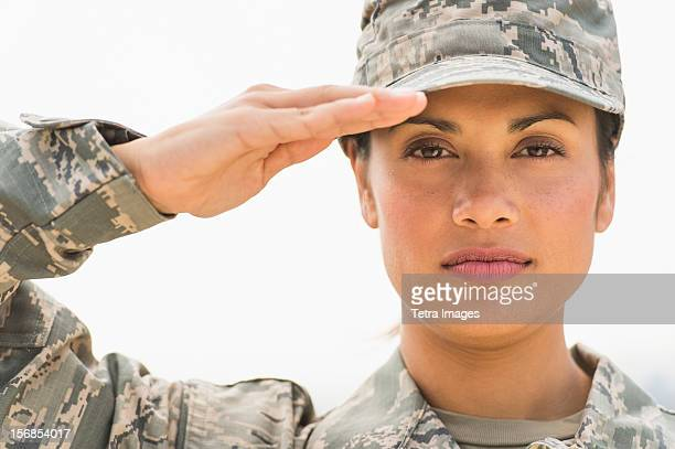 portrait of female army soldier - saluting stock pictures, royalty-free photos & images