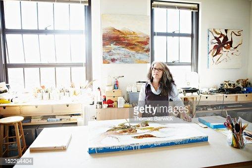 Portrait of female artist standing in studio