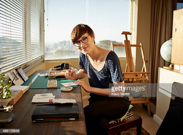 Portrait of female artist working at studio