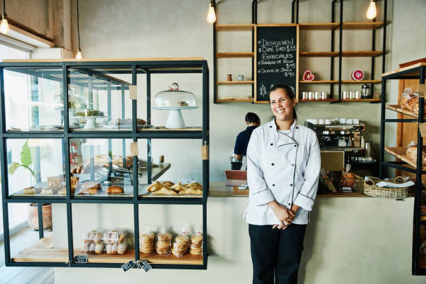 portrait of female bakery owner standing in front of counter in shop picture id976996658?k=6&m=976996658&s=612x612&w=0&h=YWkSAecdLbw jt CAHLwHIGtHqHhoKpveA VczeprwQ=