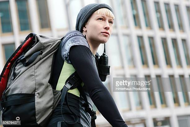 portrait of female bike messenger - bicycle messenger stock pictures, royalty-free photos & images