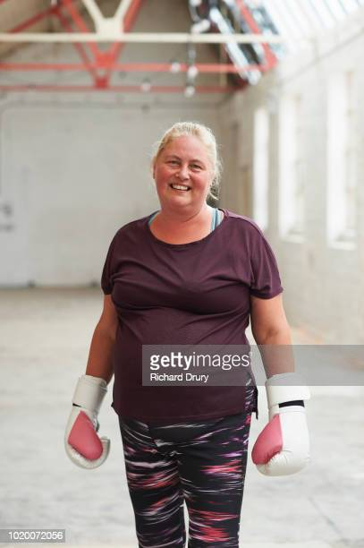 portrait of female boxer in the gym - boxing stock pictures, royalty-free photos & images