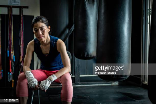 portrait of female boxer training in gym - toughness stock pictures, royalty-free photos & images