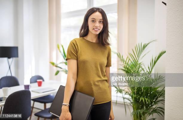 portrait of female business executive with laptop - khaki green ストックフォトと画像
