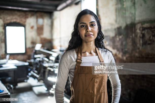 portrait of female business owner in printing shop - indian subcontinent ethnicity stock pictures, royalty-free photos & images