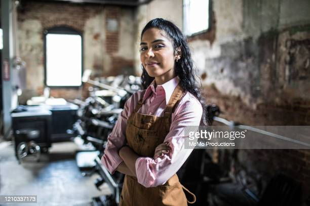 portrait of female business owner in printing shop - entrepreneur stock pictures, royalty-free photos & images