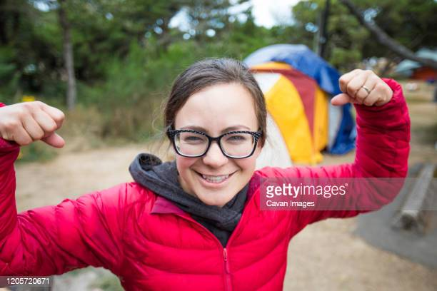 portrait of female camper showing off her muscles. - manzanita stock pictures, royalty-free photos & images