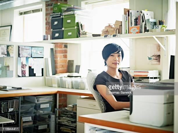 Portrait of female designer at desk in office