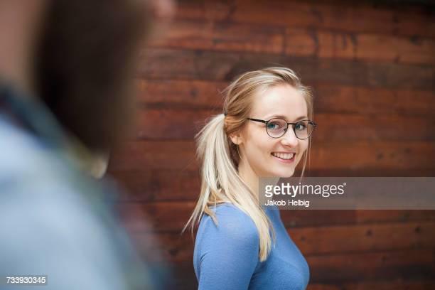 Portrait of female designer looking over her shoulder in design studio