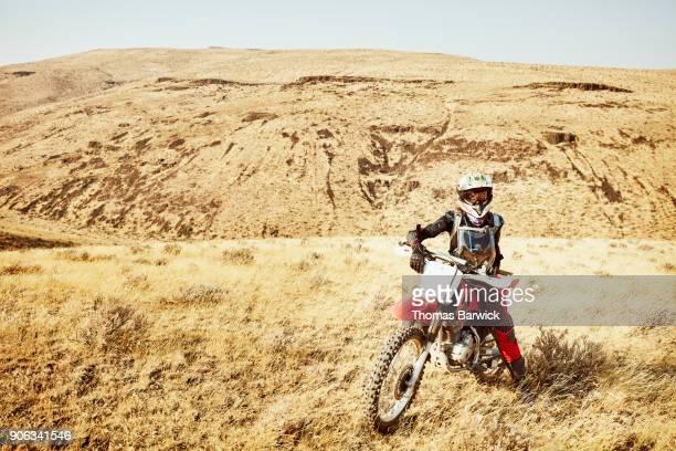 Portrait of female dirt bike rider on desert ride