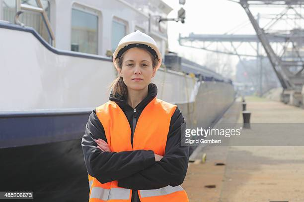 portrait of female dockworker - sigrid gombert stock pictures, royalty-free photos & images