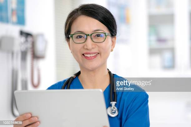 Portrait of Female Doctor with Tablet Computer