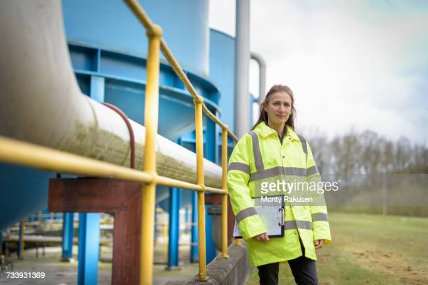 portrait of female ecologist with waste water plant of car factory - sewer stock pictures, royalty-free photos & images