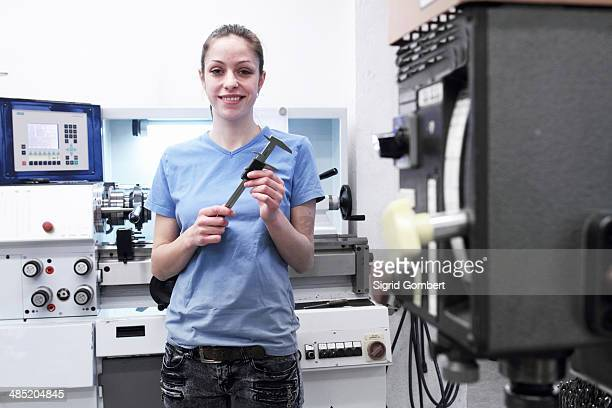 Portrait of female engineer holding tool