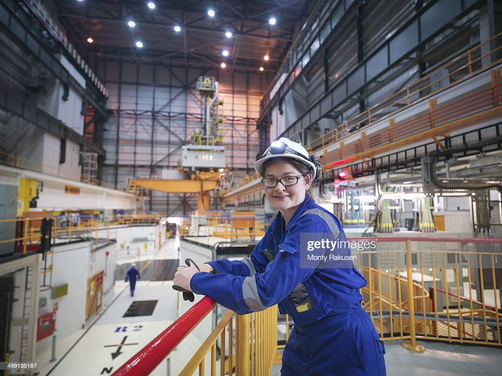 Portrait of female engineer in reactor hall in nuclear power station : Stock Photo