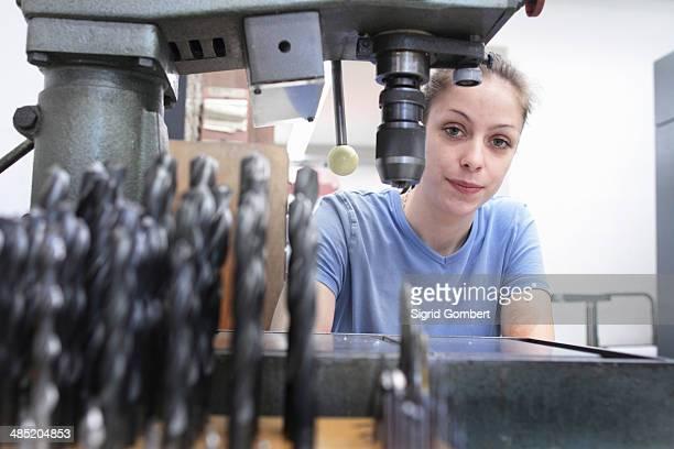Portrait of female engineer in workshop