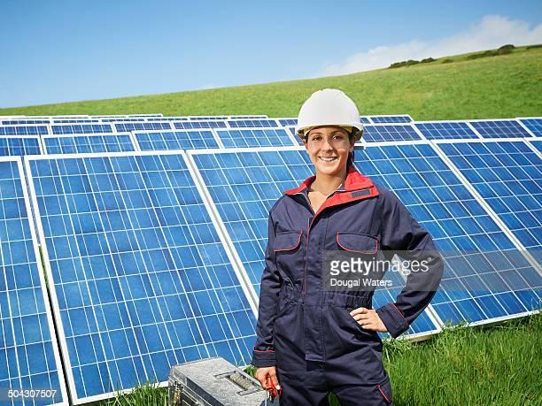 Portrait of female engineer on solar panel farm.