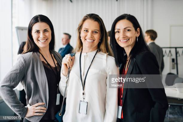 portrait of female entrepreneurs standing at workplace - employee engagement stock pictures, royalty-free photos & images