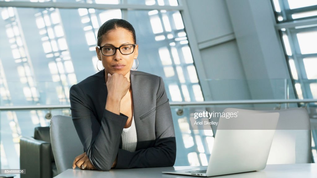 portrait of female executive in modern office stock photo getty images rh gettyimages co uk female executive office accessories female executive office wear