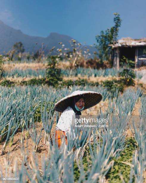 Portrait Of Female Farmer Working In Farm
