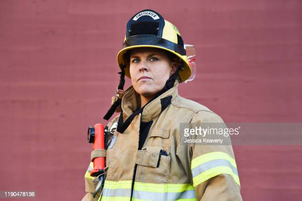 portrait of female firefighter - firefighter stock pictures, royalty-free photos & images
