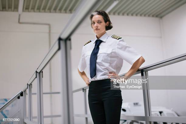 Portrait Of Female Flight Instructor Standing Proud