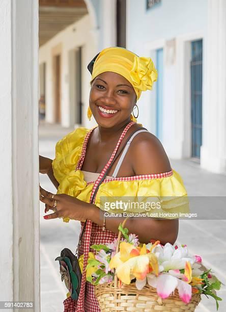 Portrait of female flower seller wearing traditional costume Havana, Cuba