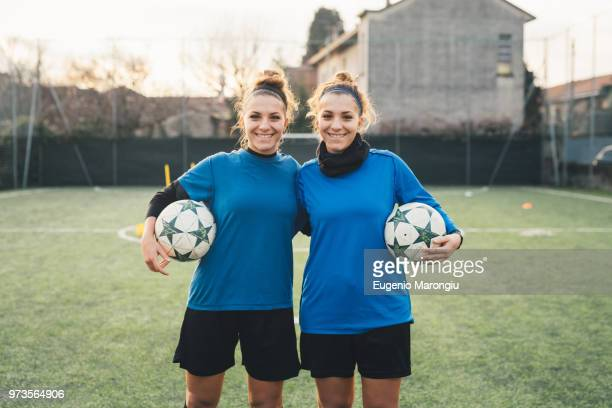 portrait of female football players - identical twin stock pictures, royalty-free photos & images