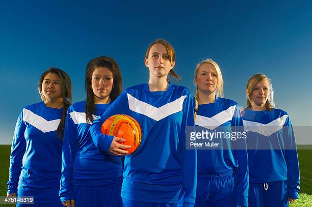portrait of female football team, young woman holding ball - football team stock pictures, royalty-free photos & images