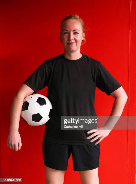 portrait of female footballer at stadium - menopossibilities stock pictures, royalty-free photos & images