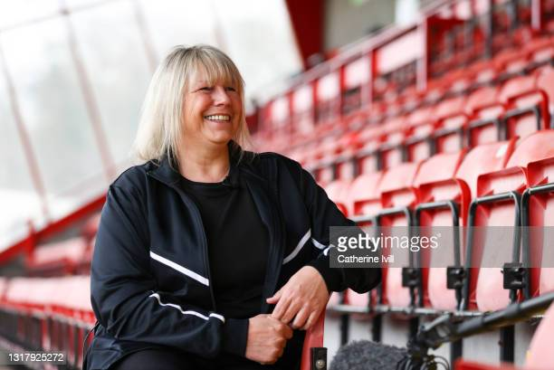 portrait of female footballer smiling - showus stock pictures, royalty-free photos & images