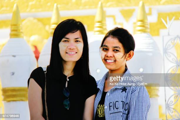 portrait of female friends with powder paint of face standing outdoors - ko ko htike aung stock pictures, royalty-free photos & images