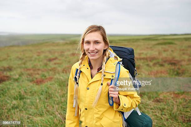 Portrait of female hiker in yellow raincoat.