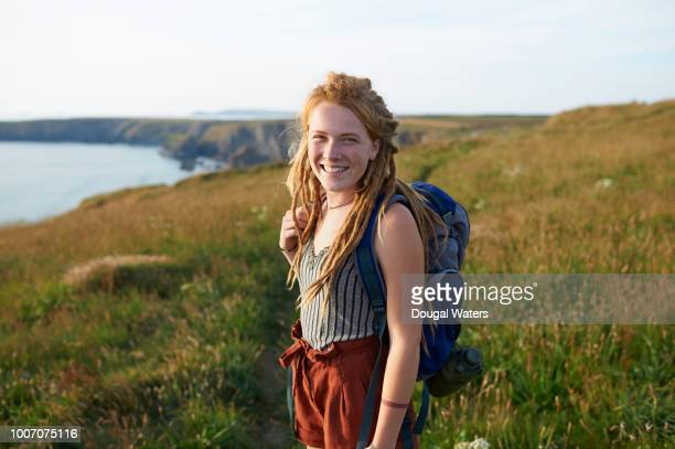 portrait of female hiker on atlantic coastline. - dougal waters stock pictures, royalty-free photos & images