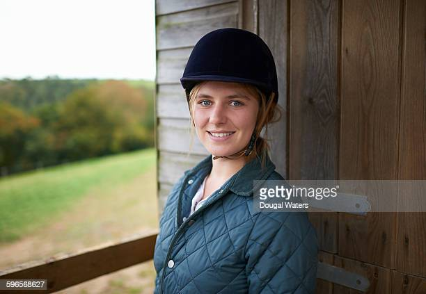 Portrait of female horse rider.