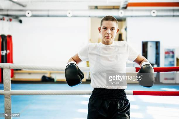 portrait of female kickboxer at her local gym - combat sport stock pictures, royalty-free photos & images