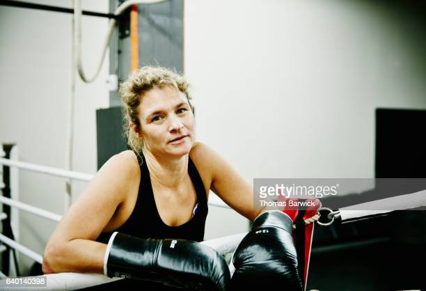 portrait of female kickboxer in ring in gym - mixed boxing stock photos and pictures