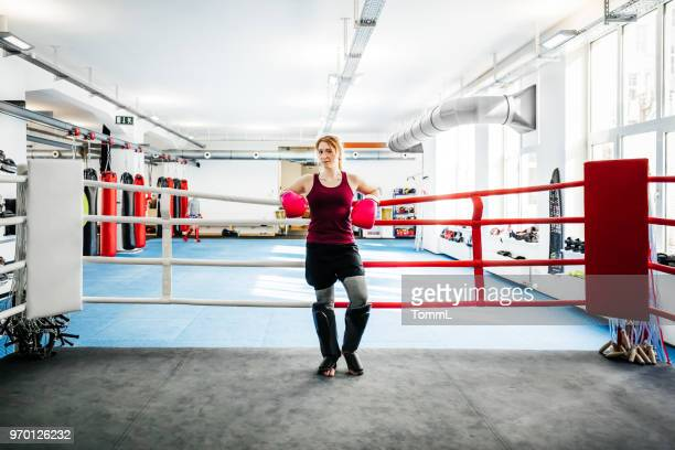 portrait of female kickboxer wearing protective gear at local gym - amateur stock pictures, royalty-free photos & images