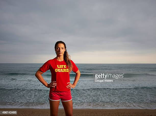 portrait of female lifeguard. - lifeguard stock pictures, royalty-free photos & images