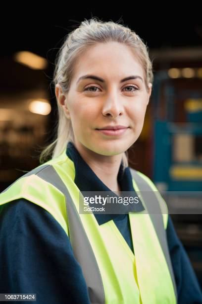 portrait of female manual worker - reflective clothing stock pictures, royalty-free photos & images