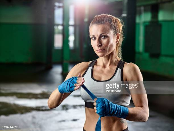 portrait of female martial artist preparing for a fight - combat sport stock pictures, royalty-free photos & images