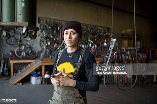 Portrait of female metalsmith in workshop