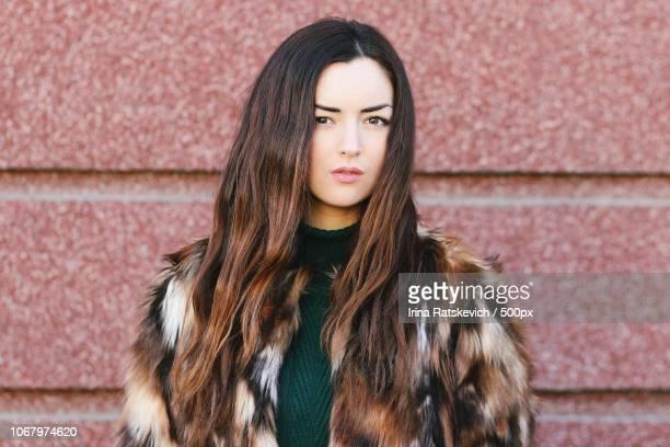 portrait of female model wearing fur coat - 毛皮のコート ストックフォトと画像