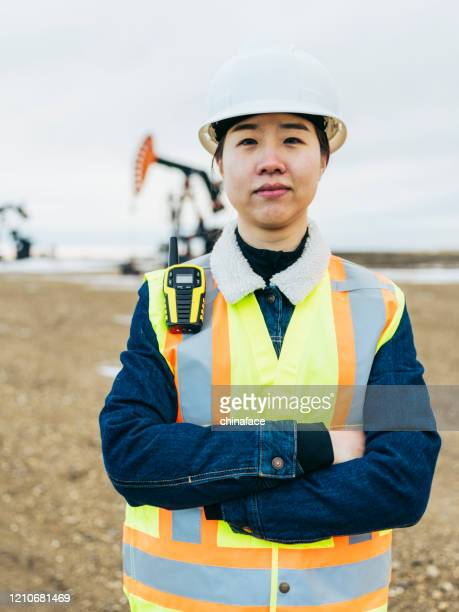 portrait of female oil worker - power occupation stock pictures, royalty-free photos & images