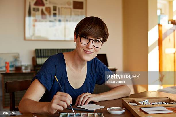 Portrait of female painter working from home