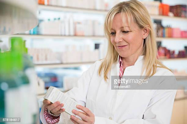 Portrait of female pharmacist doing inventory control