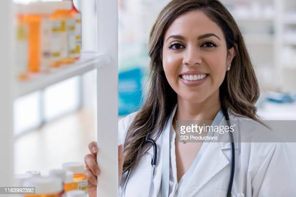 portrait of female pharmacist - long hair stock pictures, royalty-free photos & images