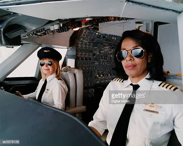 portrait of female pilots sitting at the cockpit - piloting stock pictures, royalty-free photos & images