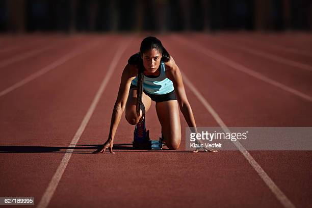Portrait of female runner getting ready